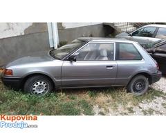 Mazda 323 popaj